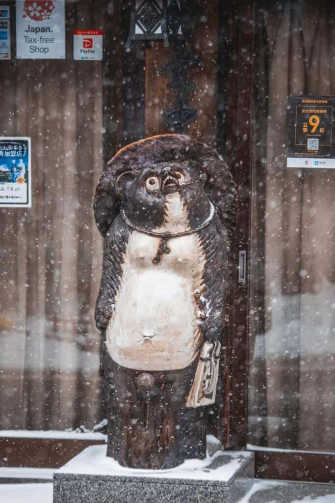 tanuki statue outside a restaurant in japan