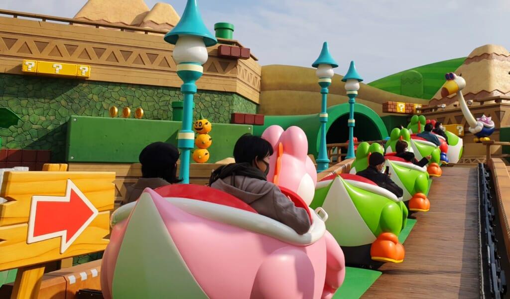 Montez à bord des voitures à l'effigie de Yoshi dans Yoshi's Adventure