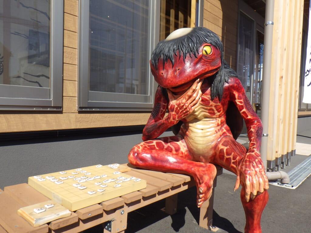 fotografia de una escultura kappa en fukusaki